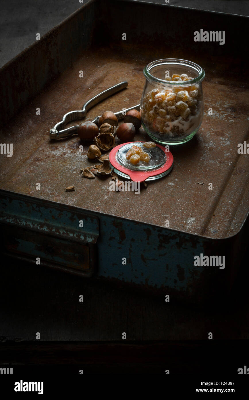 Home-made candied orange peel in jar in rustic decoration - Stock Image