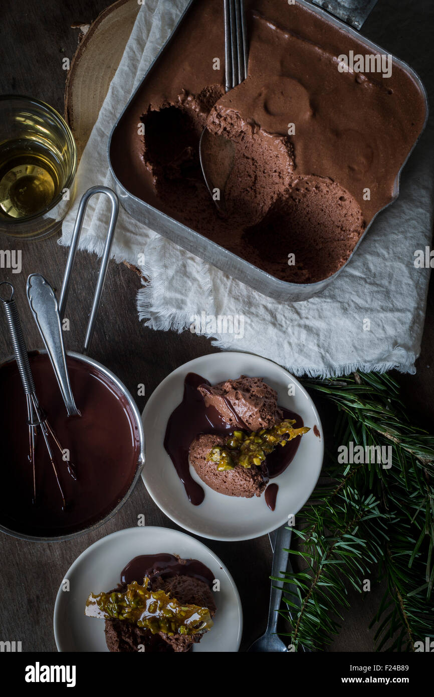 Single malt & chocolate mousse in vintage tin pot on dark wooden ground with Christmas decoration. Top view - Stock Image