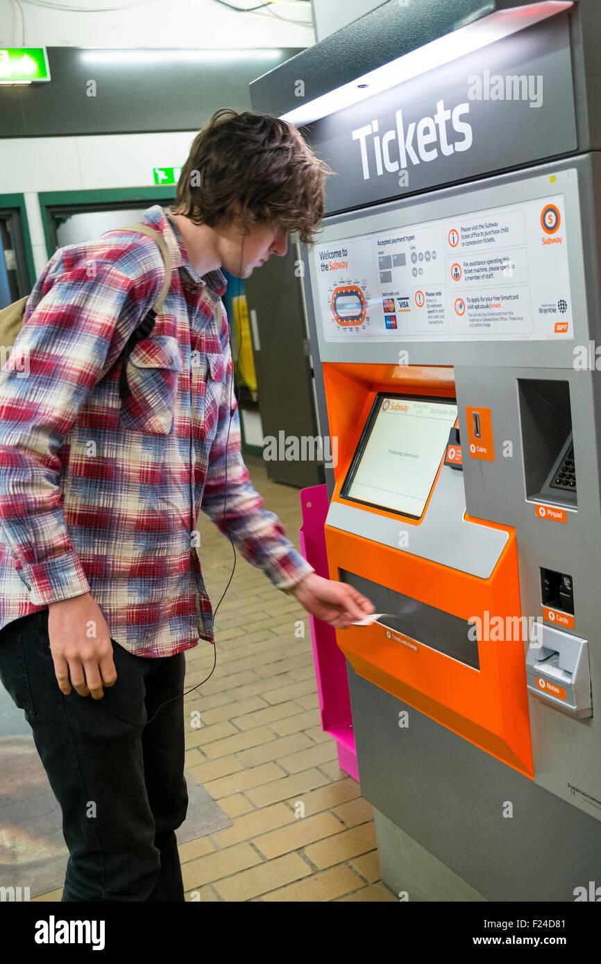 person male ticket machine glasgow subway station - Stock Image