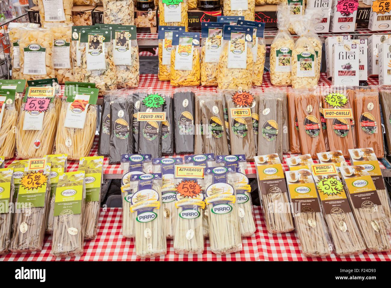 Different types of pasta for sale on a market stall in the Piazza campo de' Fiori Rome Italy roma lazio Italy - Stock Image