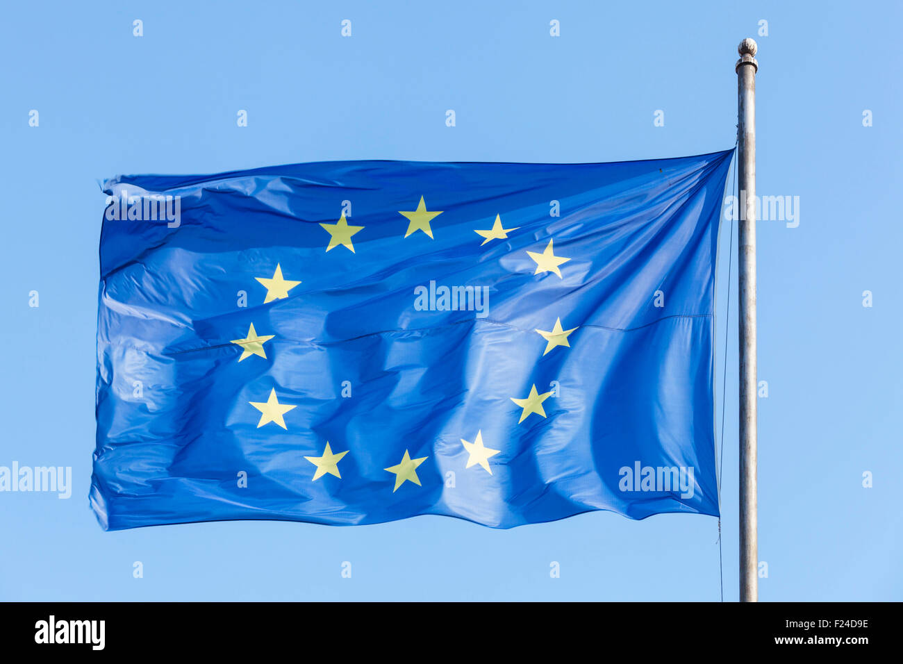 EU flag flying against a blue sky fluttering in the wind - Stock Image