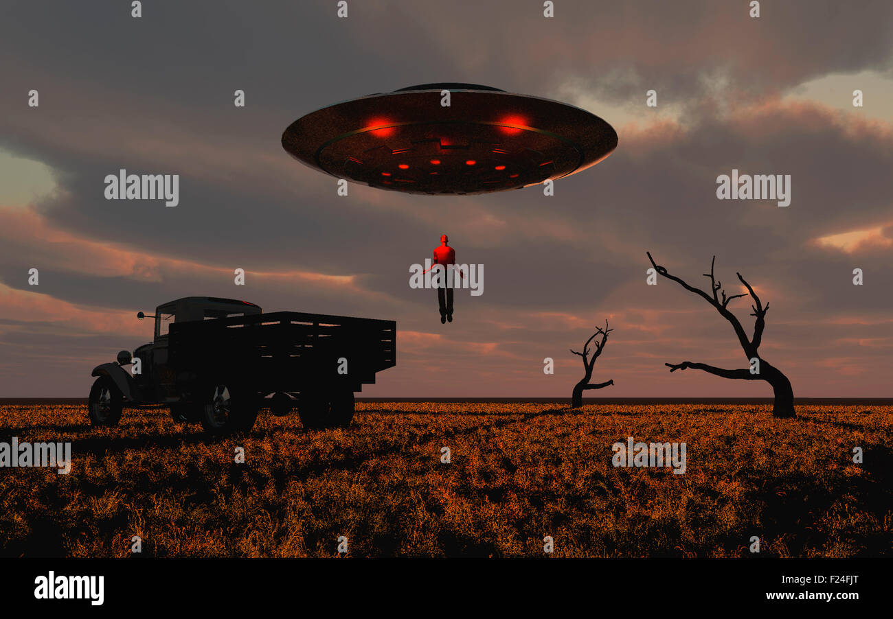 Alien Abduction : A Man Being Levitated Into A UFO. Stock Photo
