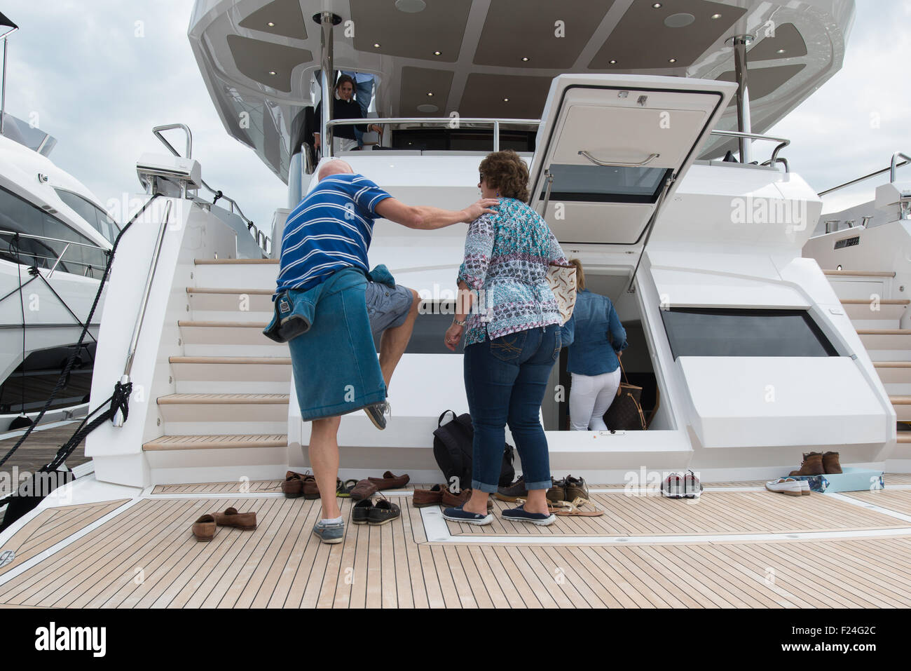 Southampton, UK. 11th September 2015. Southampton Boat Show 2015. Show visitors remove their shoes before boarding Stock Photo