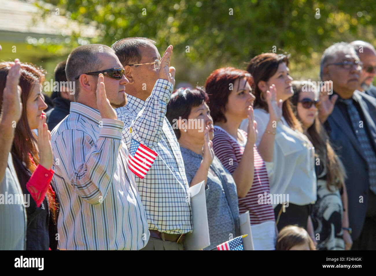 Immigrants from 22 different countries take the oath of allegiance during a naturalization ceremony in Yellowstone - Stock Image