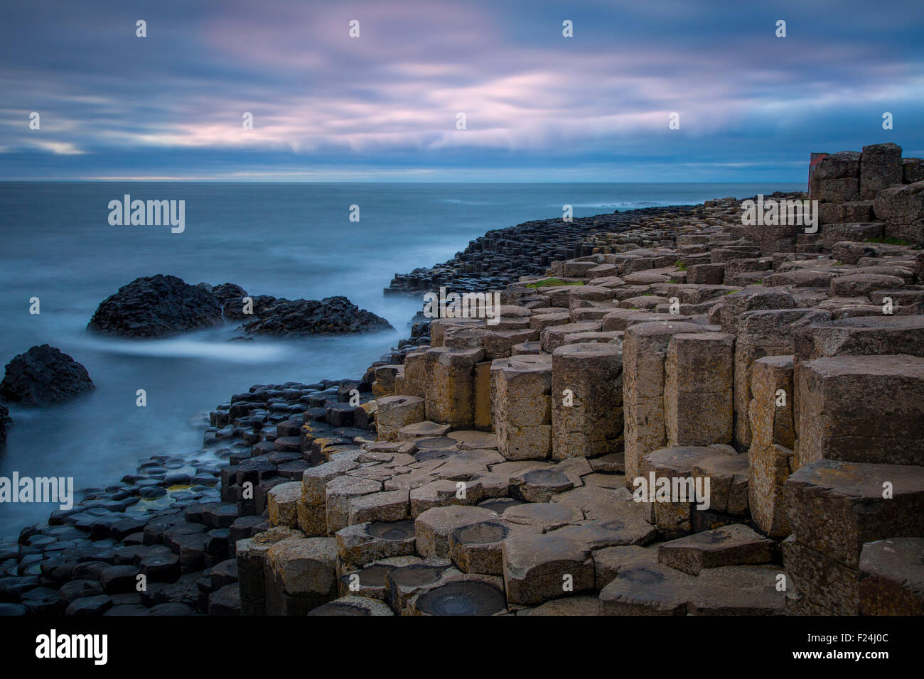 Twilight over the Giant's Causeway along the northern coast, County Antrim, Northern Ireland, UK Stock Photo