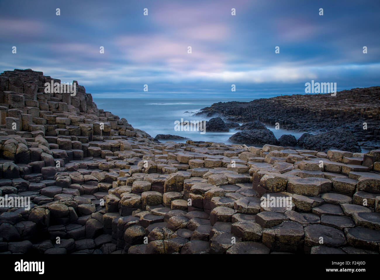 Twilight over the Giant's Causeway along the northern coast, County Antrim, Northern Ireland, UK - Stock Image