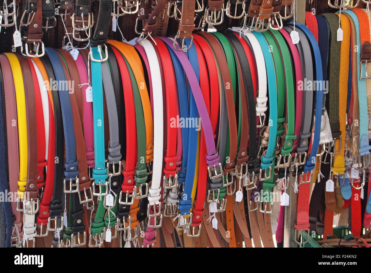 Belts on sale cheaply in a market stall in Minorca - Stock Image