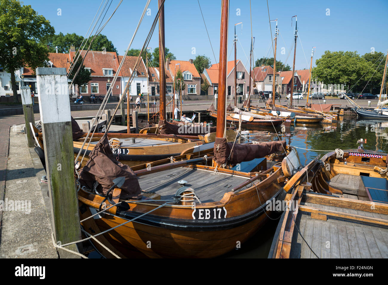 Historical fishing boats in the harbor of the hanseatic city Elburg in the Netherlands - Stock Image