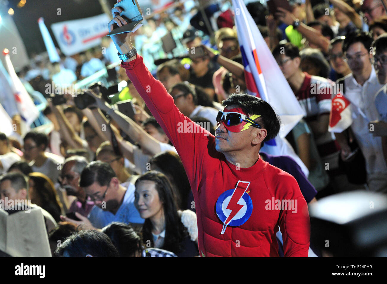 Singapore. 12th Sep, 2015. Supporters of Singapore's People's Action Party (PAP) wave party flags at the - Stock Image