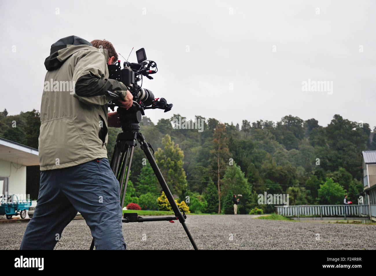 Cameraman and sound recordist at work on the lake - Stock Image