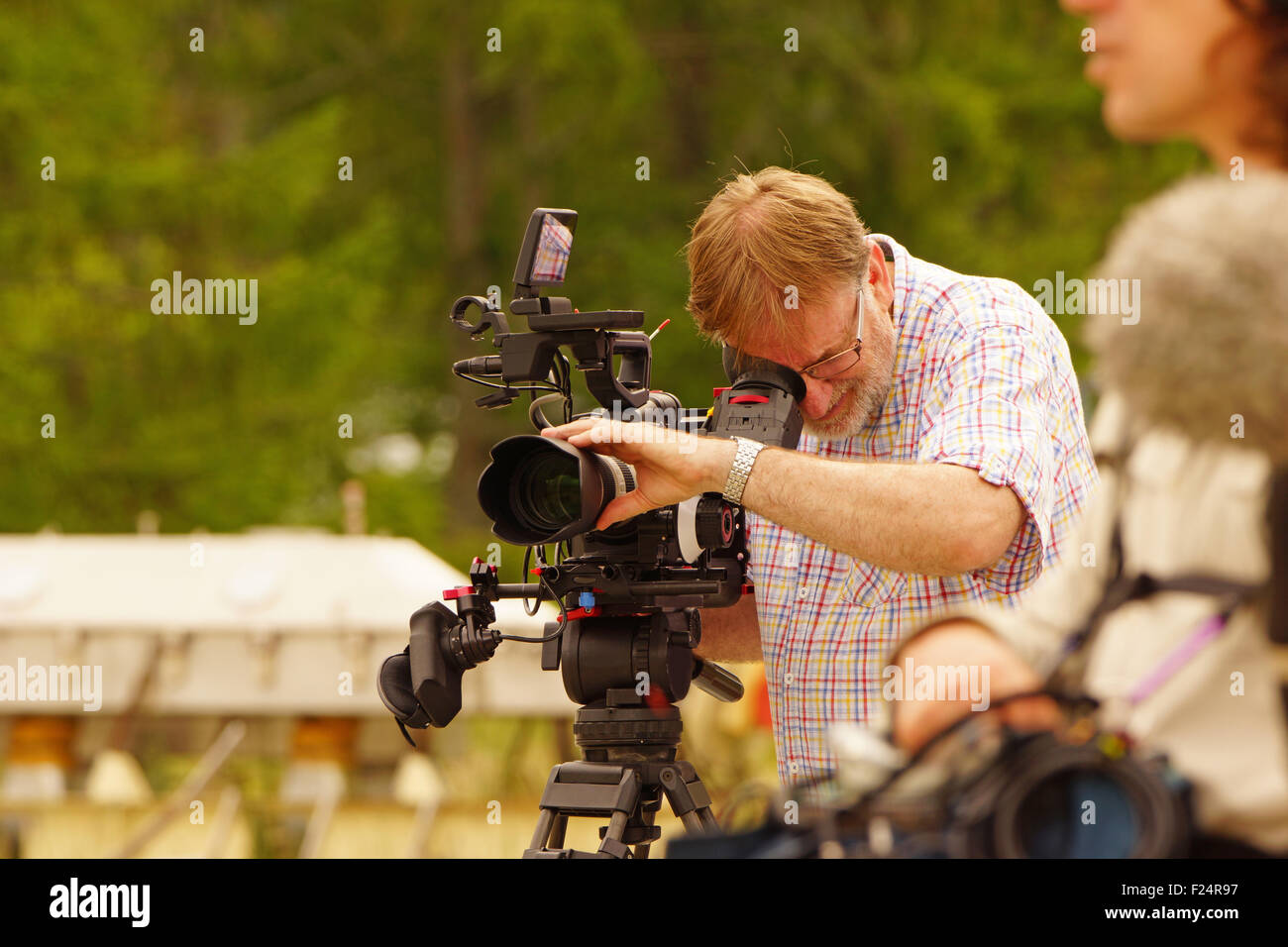 Cameraman and sound recordist at work - Stock Image