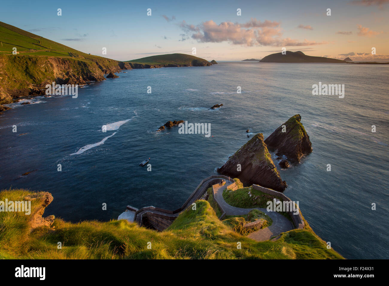 Sunset over windy road to Dunquin Harbor, Dunquin, County Kerry, Republic of Ireland - Stock Image