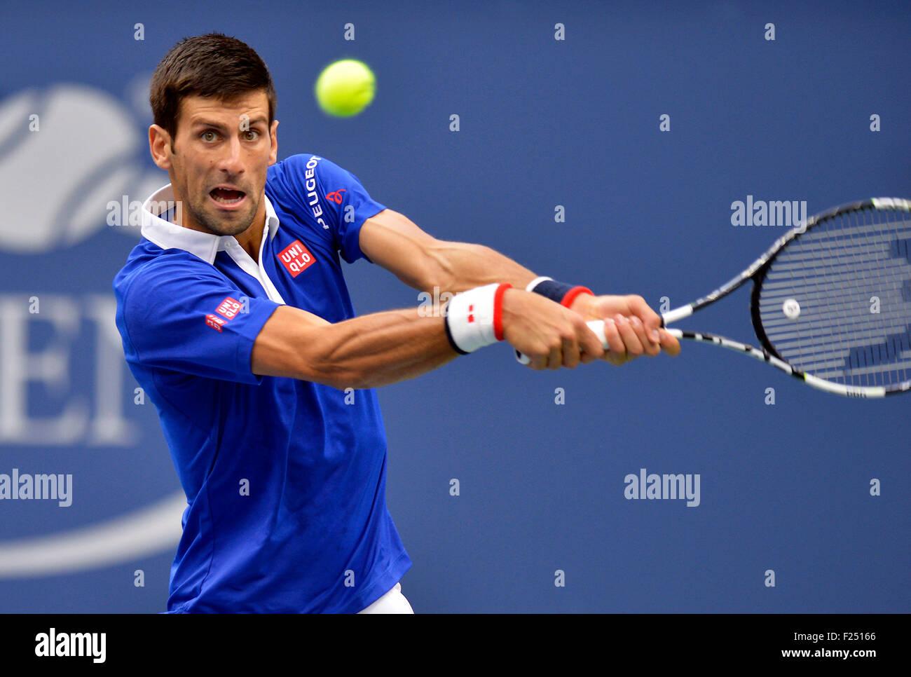 New York, USA. 11th Sep, 2015. Novak Djokovic of Serbia returns a shot to Marin Cilic of Croatia during their men's - Stock Image