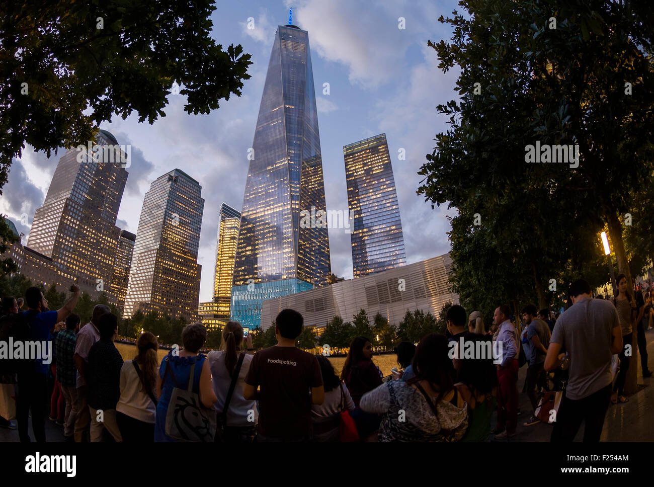 New York, NY - September 11th 2015 - People surround the reflecting pools at the 911 Memorial and Museum on the - Stock Image