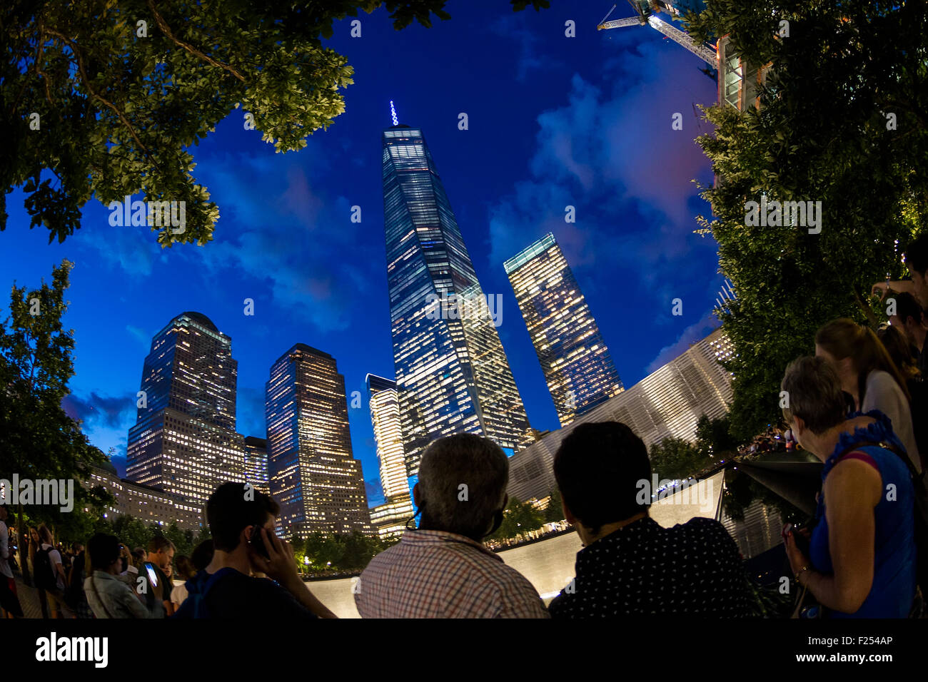 New York, NY - September 11th 2015 - People watch night fall at the 911 Memorial and Museum on the 13th Anniversary - Stock Image