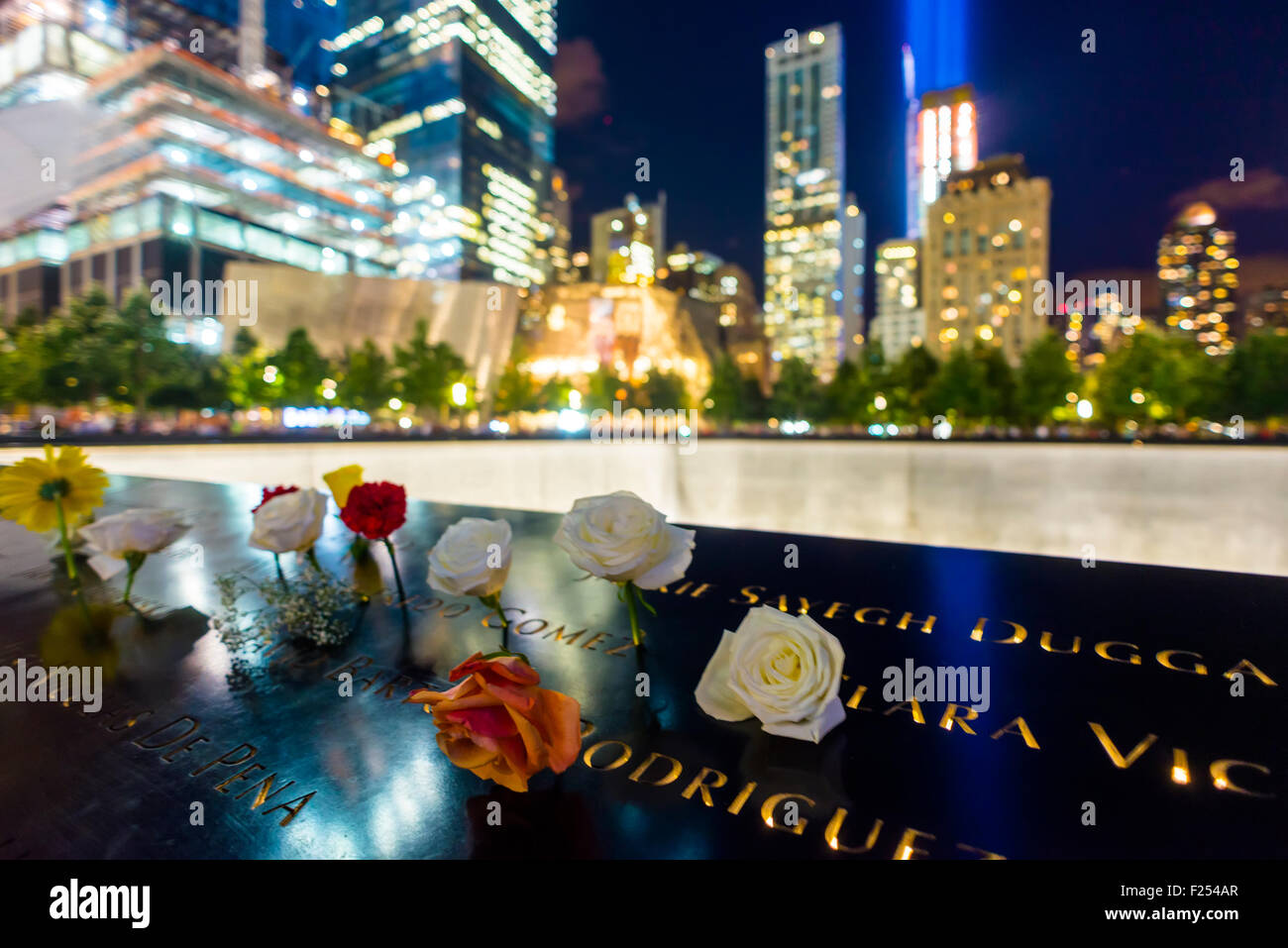 New York, NY - September 11th 2015 - Flowers surround the reflecting pools at the 911 Memorial and Museum on the - Stock Image