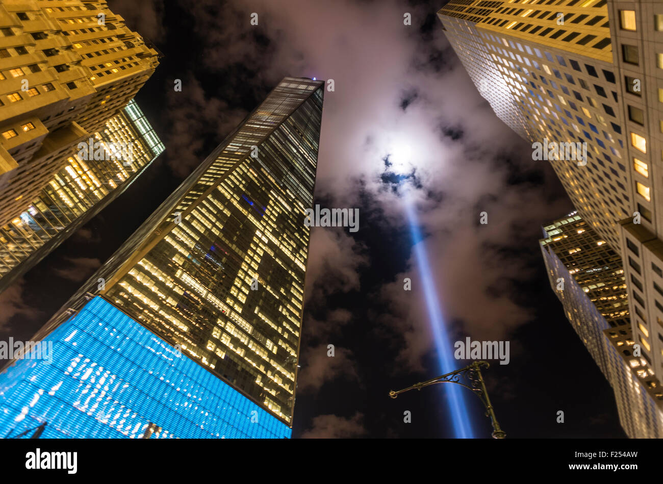 New York, NY - September 11th 2015 - One World Trade Center and Tribute in Light, shines over lower Manhattan on - Stock Image