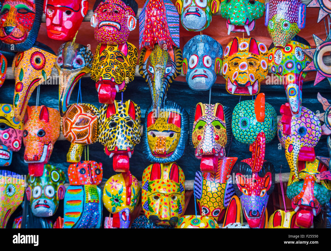 mayan wooden masks for sale at chichicastenango market in