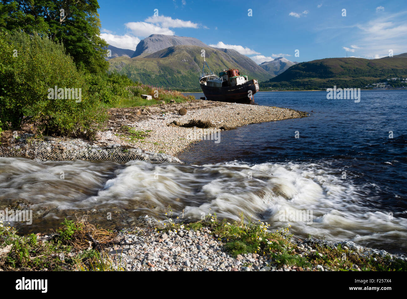 Shipwreck on the shores of Loch Linnhe near Fort William in the West Highlands of Scotland with Ben Nevis in the Stock Photo