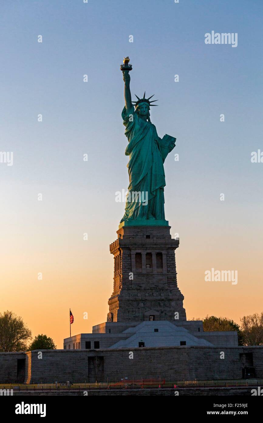 United States, New York, the Statue of Liberty at sunset - Stock Image