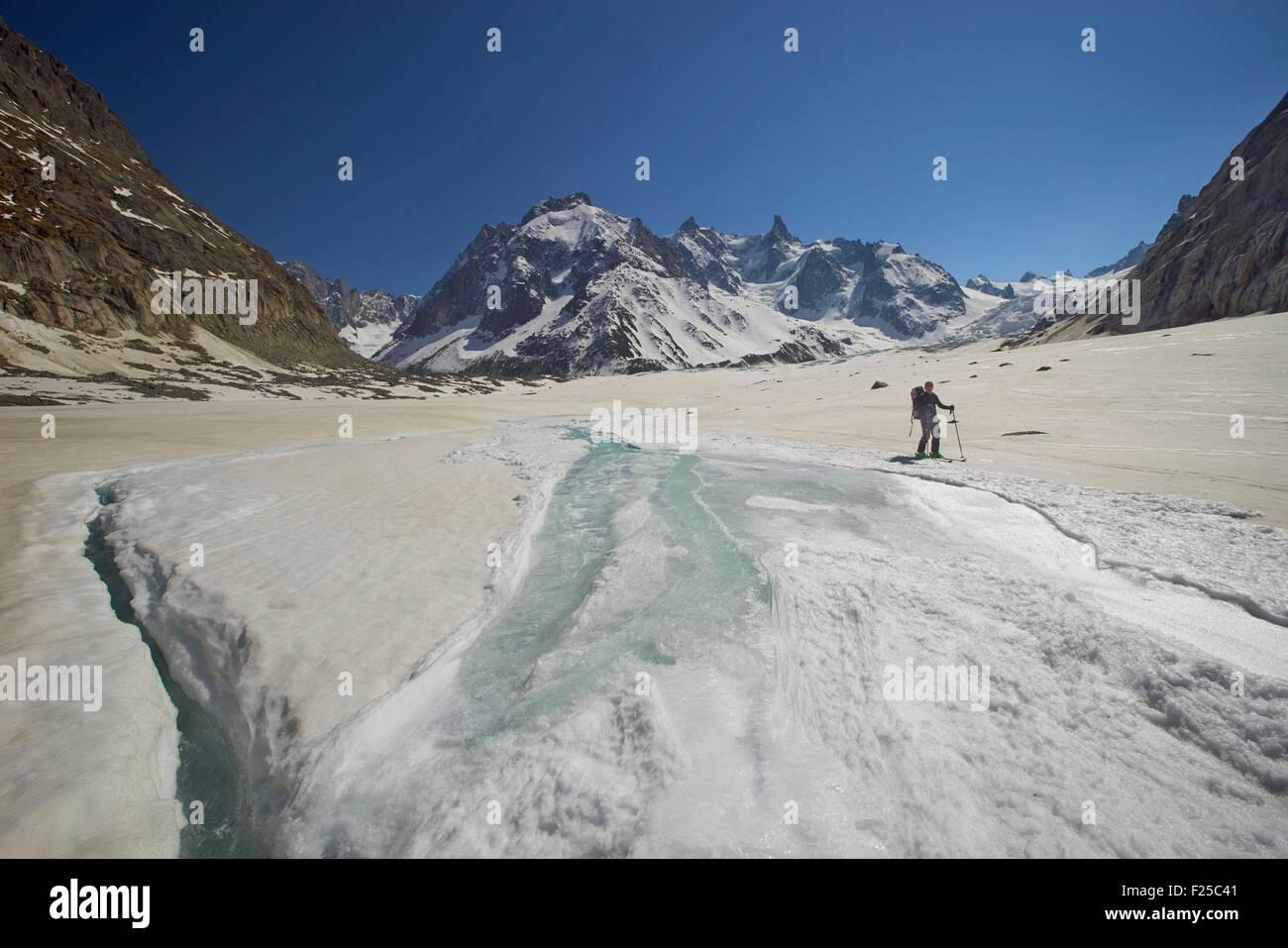 France, Haute Savoie, Chamonix, running water on the Mer de Glace, Mont Blanc range - Stock Image