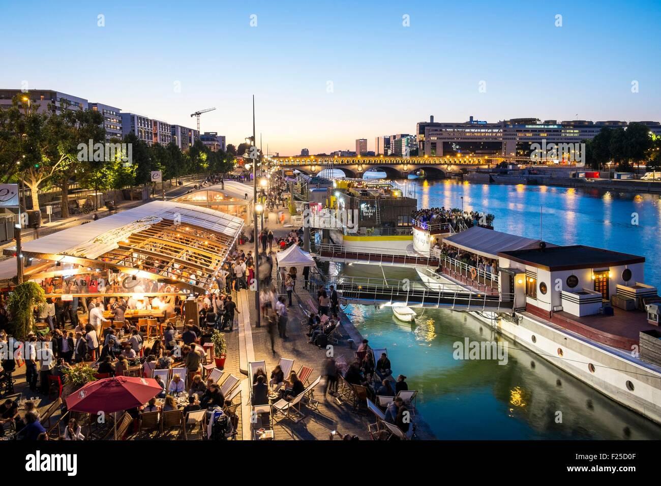 France, Paris, Quai Franτois Mauriac, in summer beach restaurants settled along the Seine, in the foreground Vagalame Stock Photo