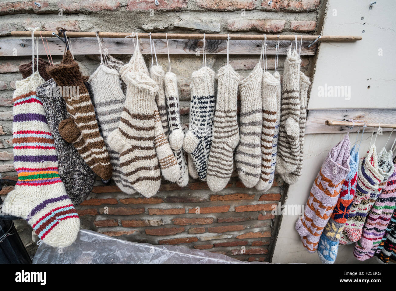 wool socks for sale on souvenir stand in Sighnaghi, Kakheti region of Georgia - Stock Image