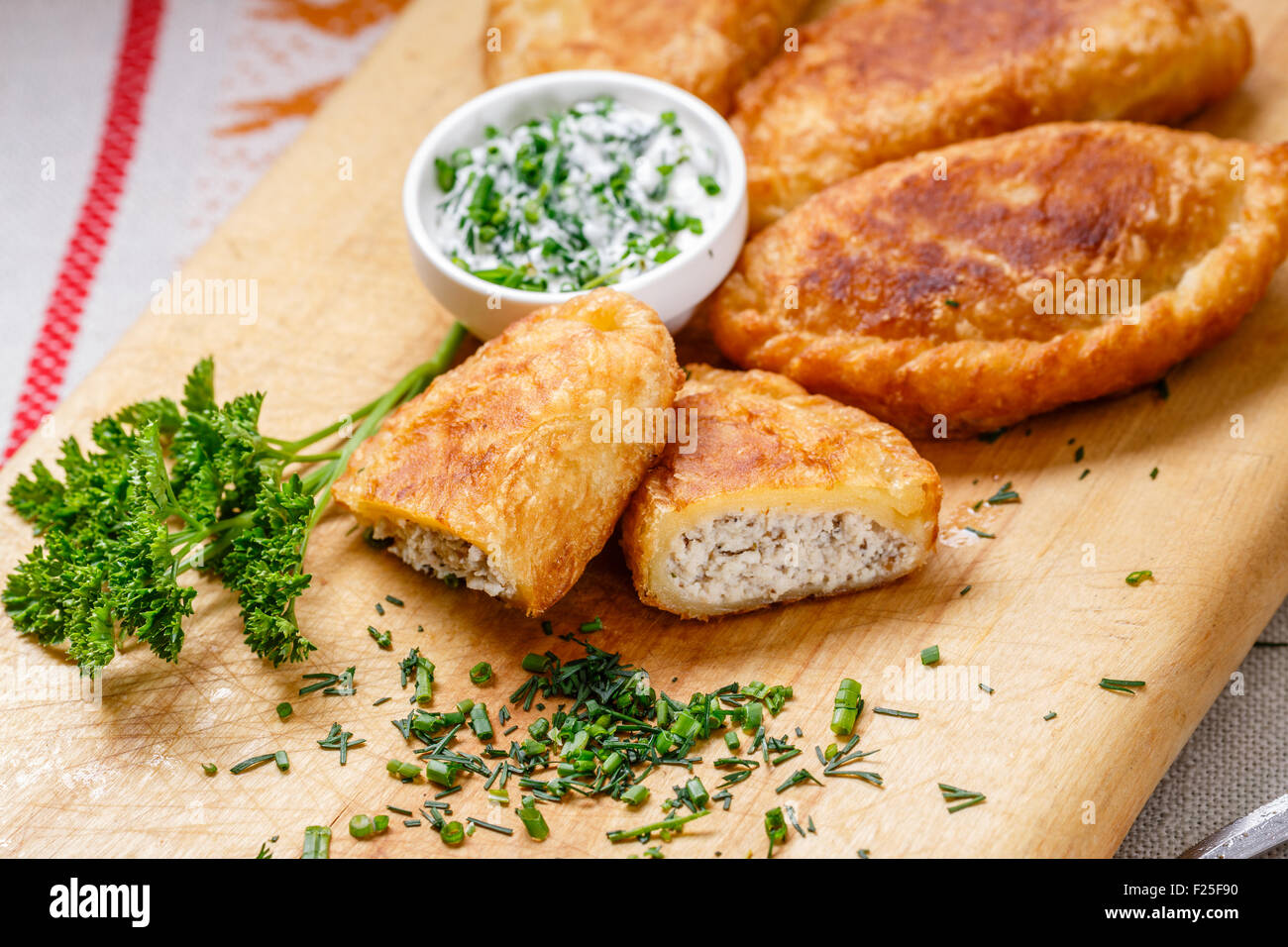 Colombian empanadas (snack sized savory patties) on wooden board. Latin cuisine Stock Photo