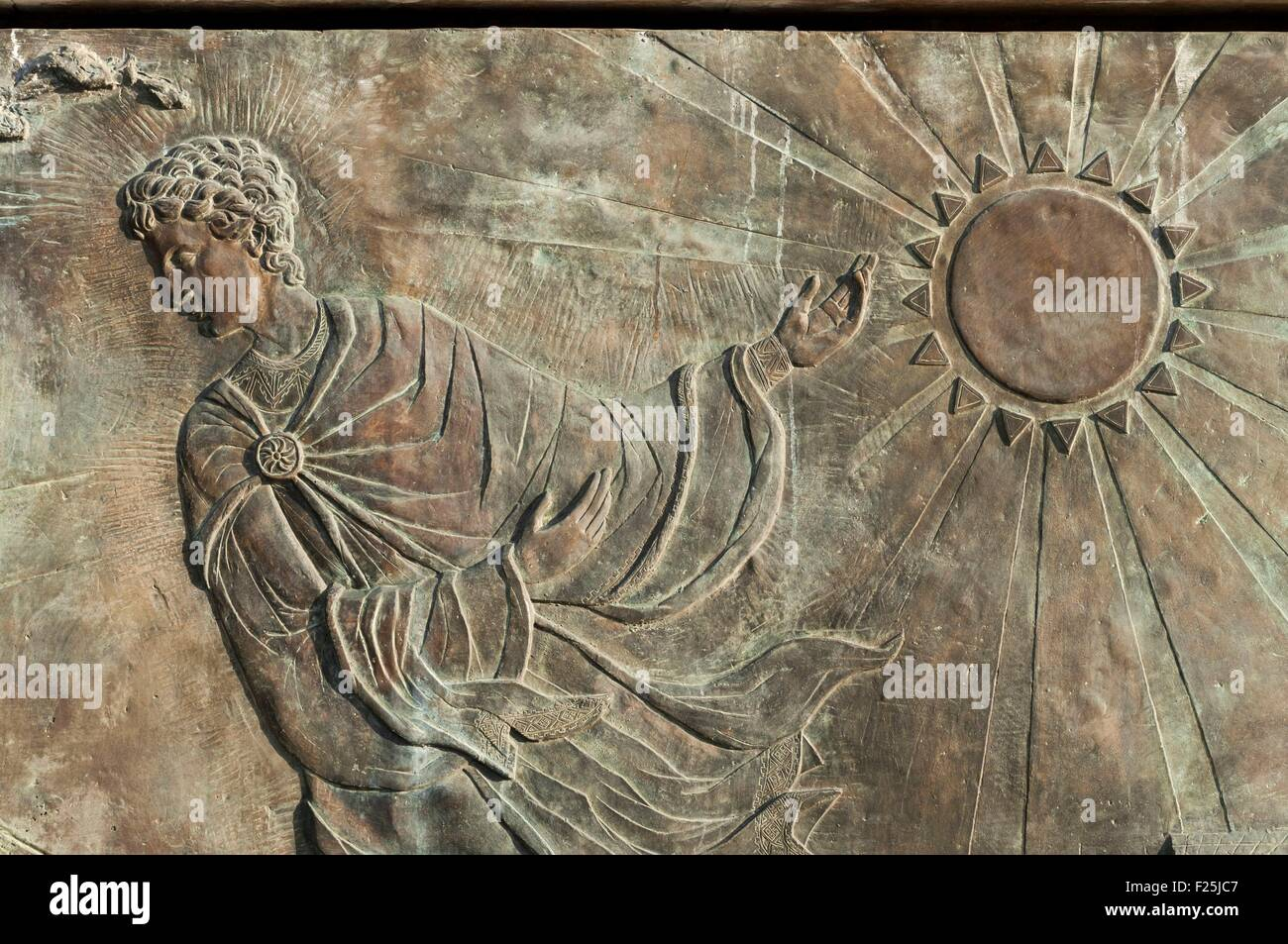 Macedonia, Skopje, detail of a bas relief under statue in dowtown, similar to the national flag sun - Stock Image