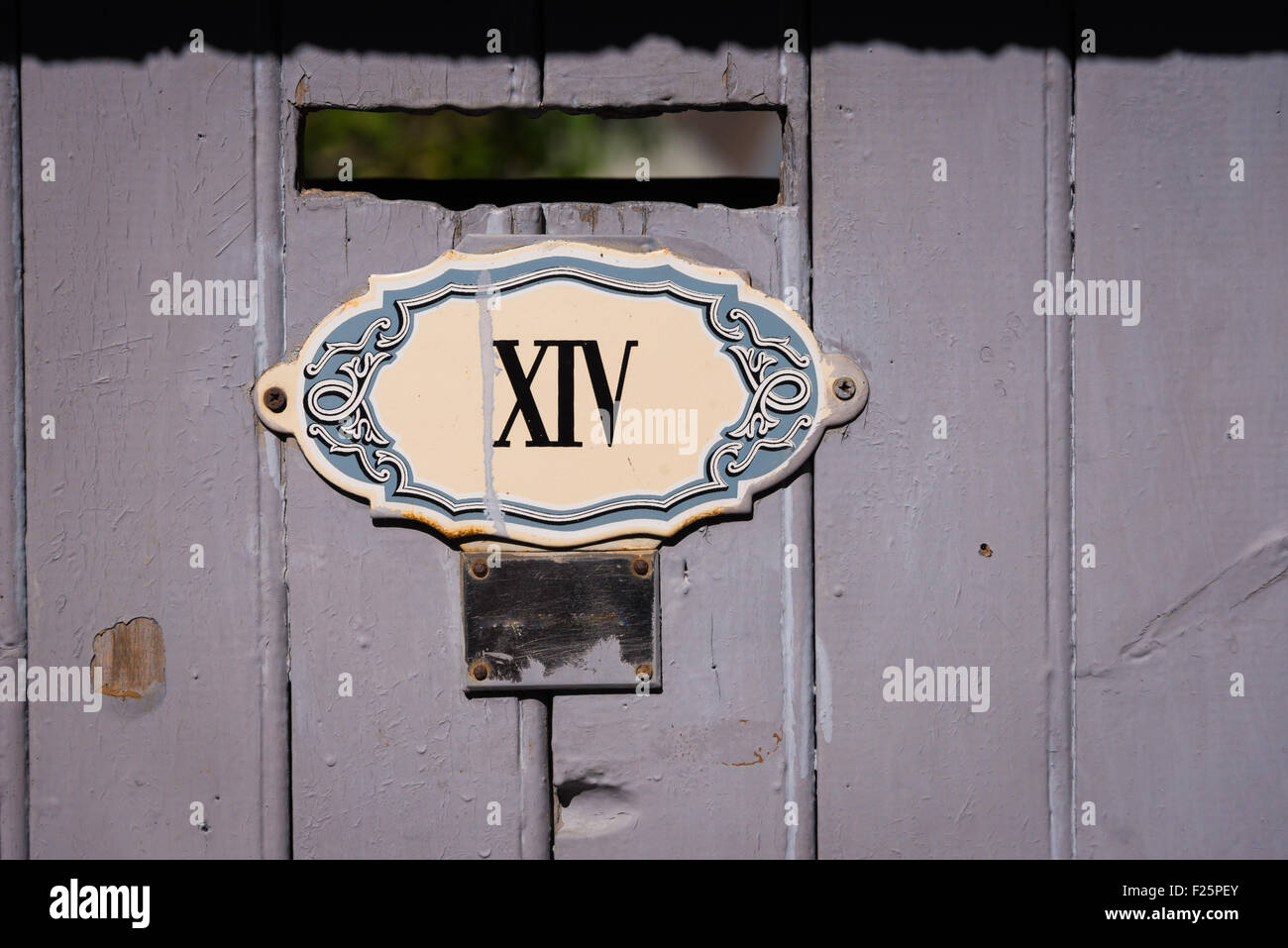 House number in Roman numerals  in the Haut Savoie village of Conflans, France - Stock Image