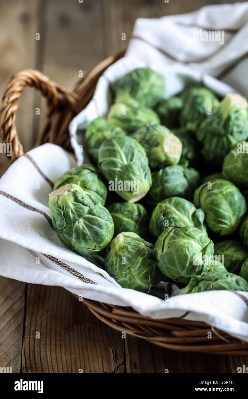 Fresh brussel sprouts in a basket. - Stock Image