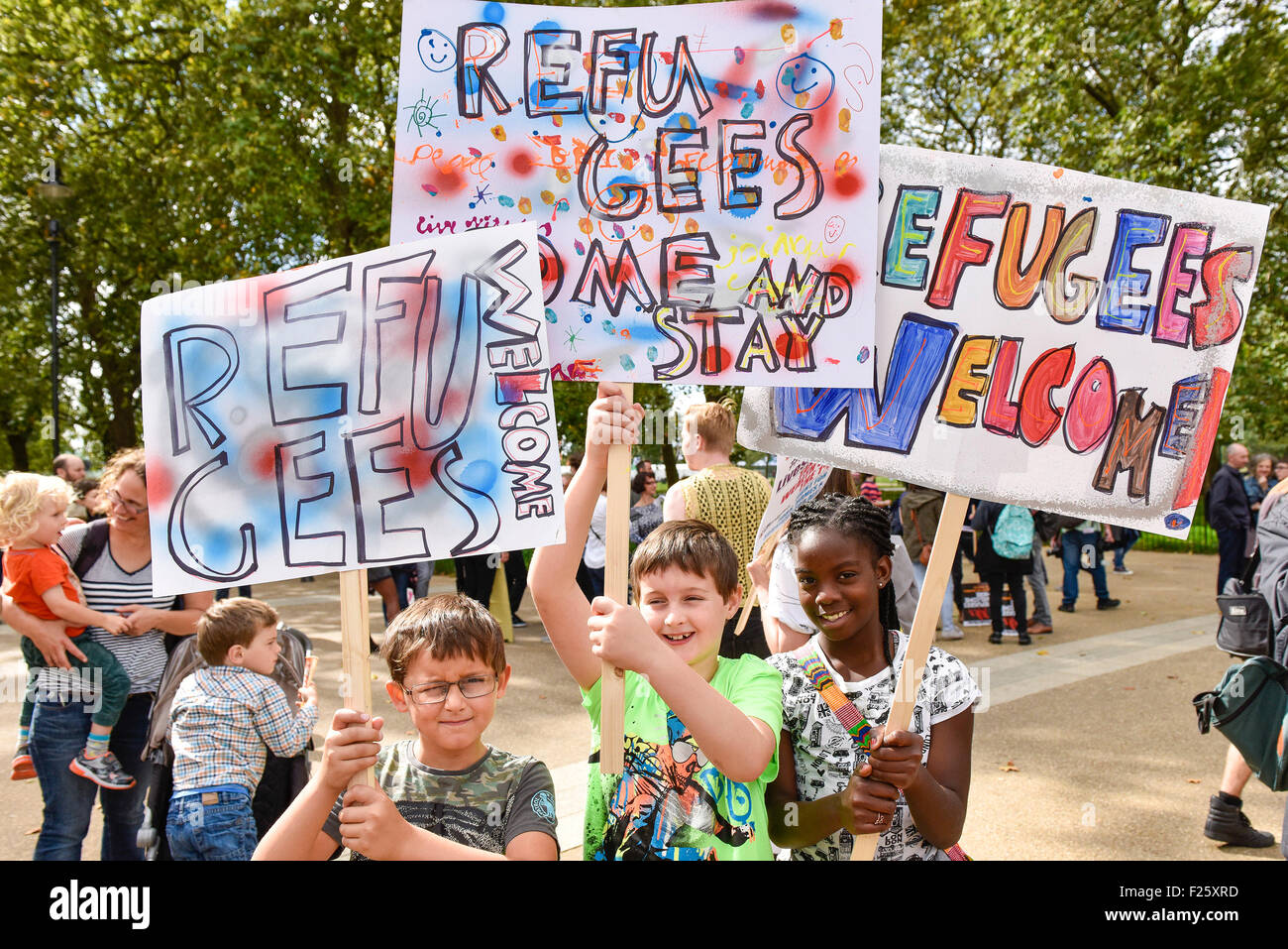 London, UK. 12th September 2015. Maria, Dylan and Max proudly display their colourful placards as they march in - Stock Image