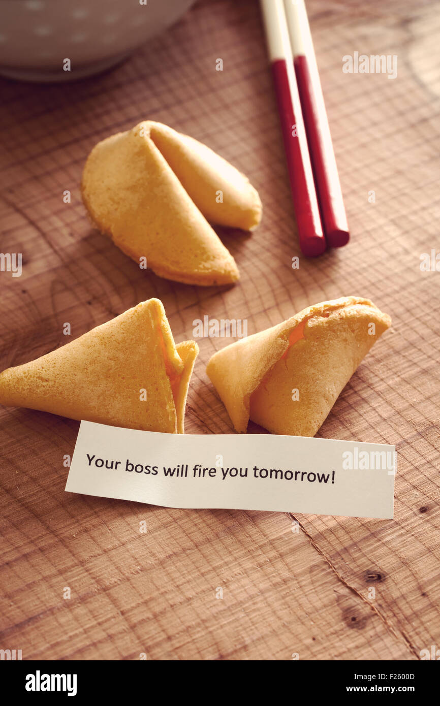 Fortune Cookie with a bad luck firing message vintage filter applied to image - Stock Image