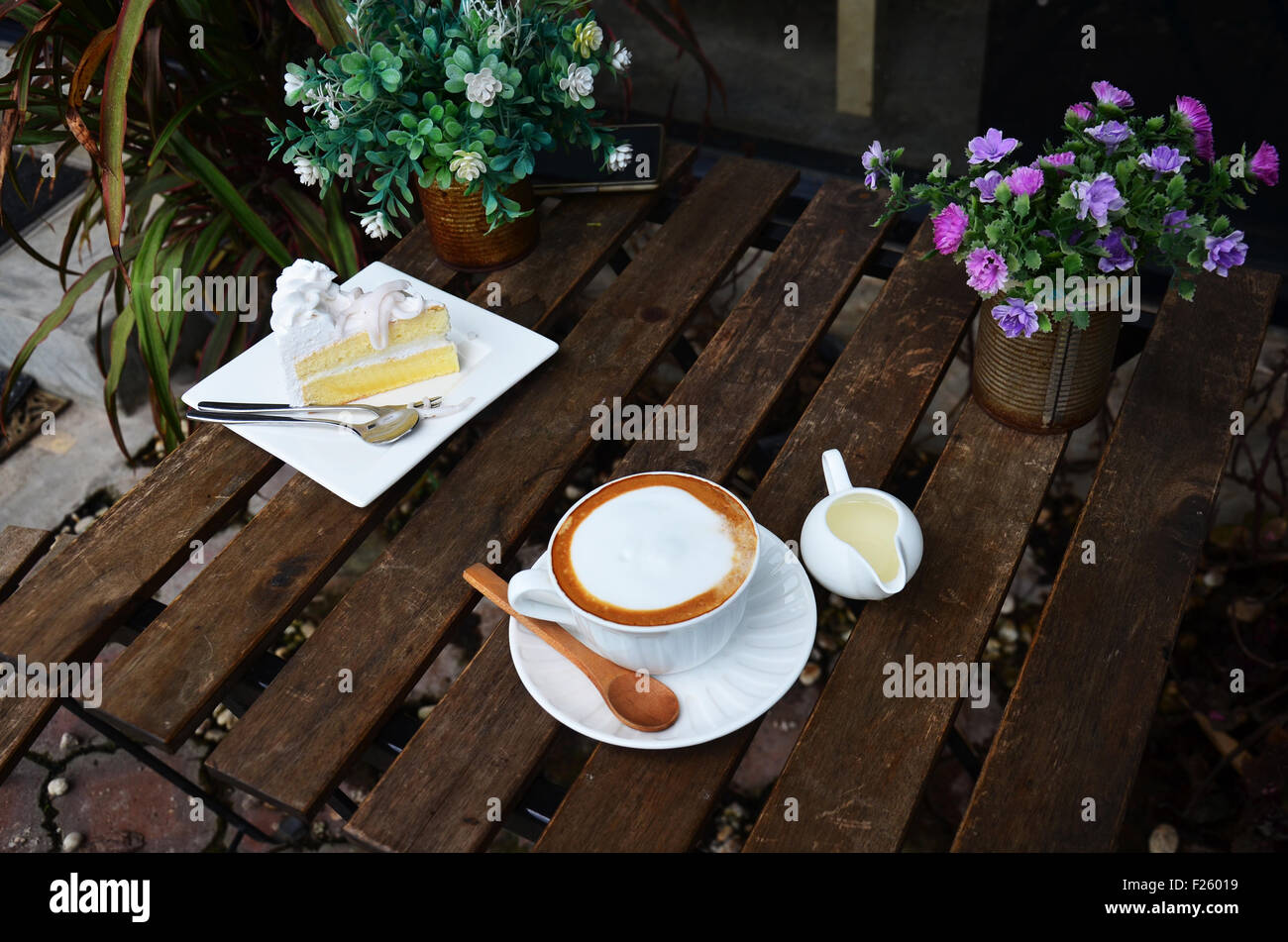 Hot Coffee And Coconut Cake On Table In Garden Of Coffee Shop Stock Photo Alamy