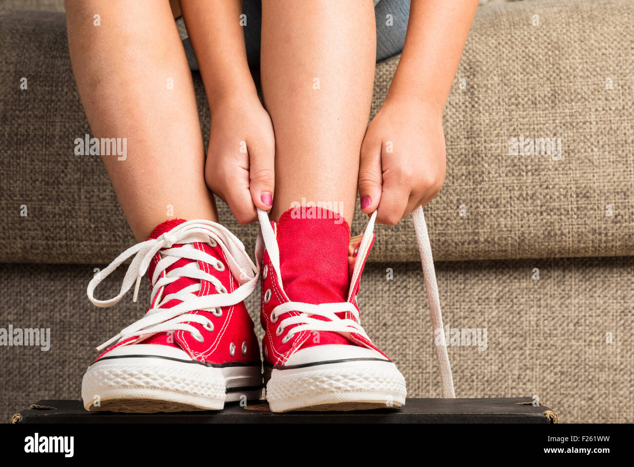 red sneakers at home Stock Photo