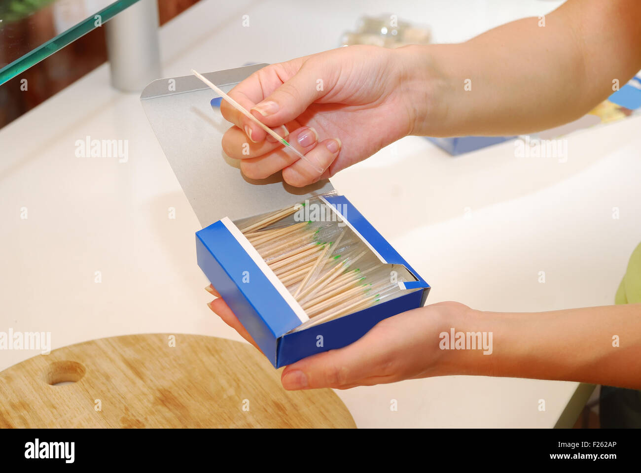 hands showing how to use toothpicks in box - Stock Image