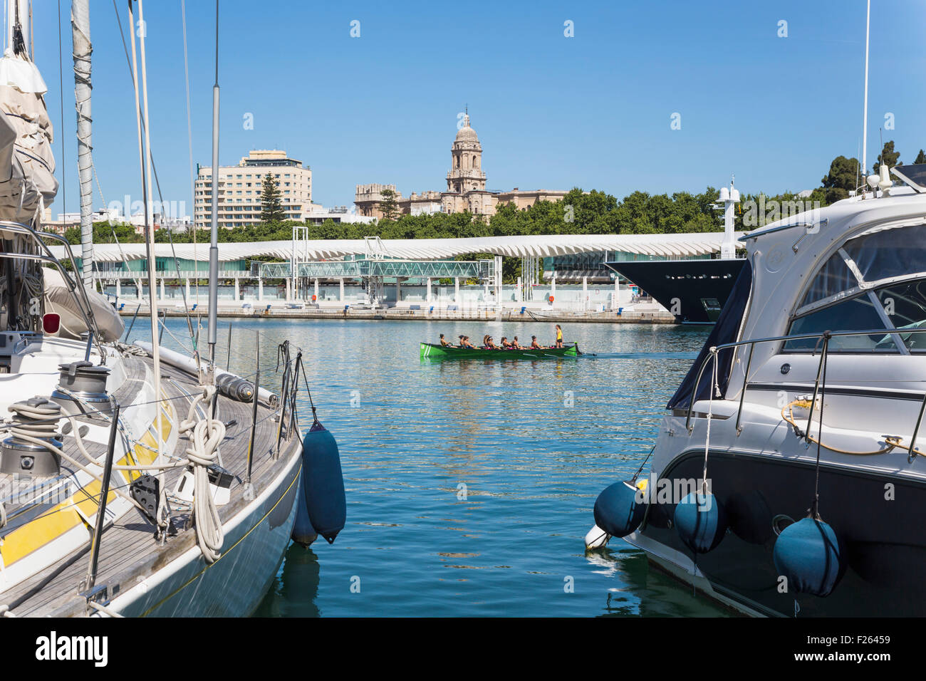 Malaga, Malaga Province, Costa del Sol, Andalusia, southern Spain. All women crew rowing across bay, in craft known - Stock Image