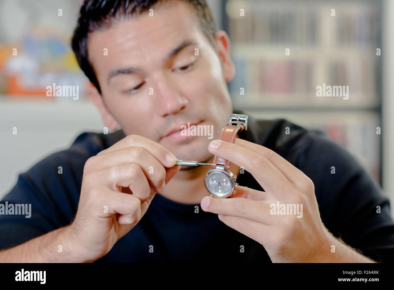 Watch repair man - Stock Image