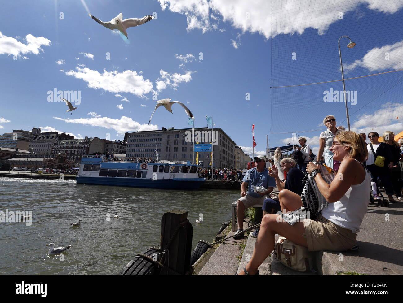 Helsinki, Finland. 1st Aug, 2015. People feeding seagulls . © Valery Matytsin/TASS/Alamy Live News - Stock Image