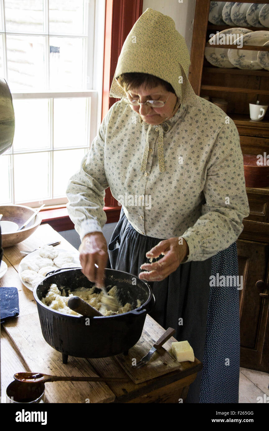 An interpreter prepares a fish stew at the 1860 Doucet Farm, at Village Historique Acadien, Caraquet, New Brunswick, - Stock Image