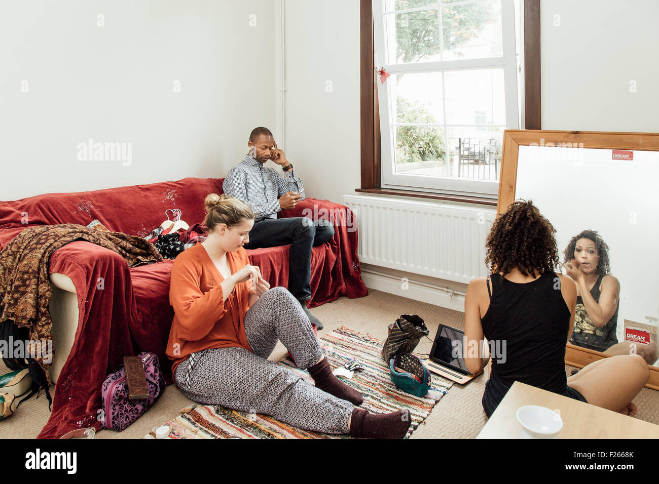 Students preparing for a night out - Stock Image