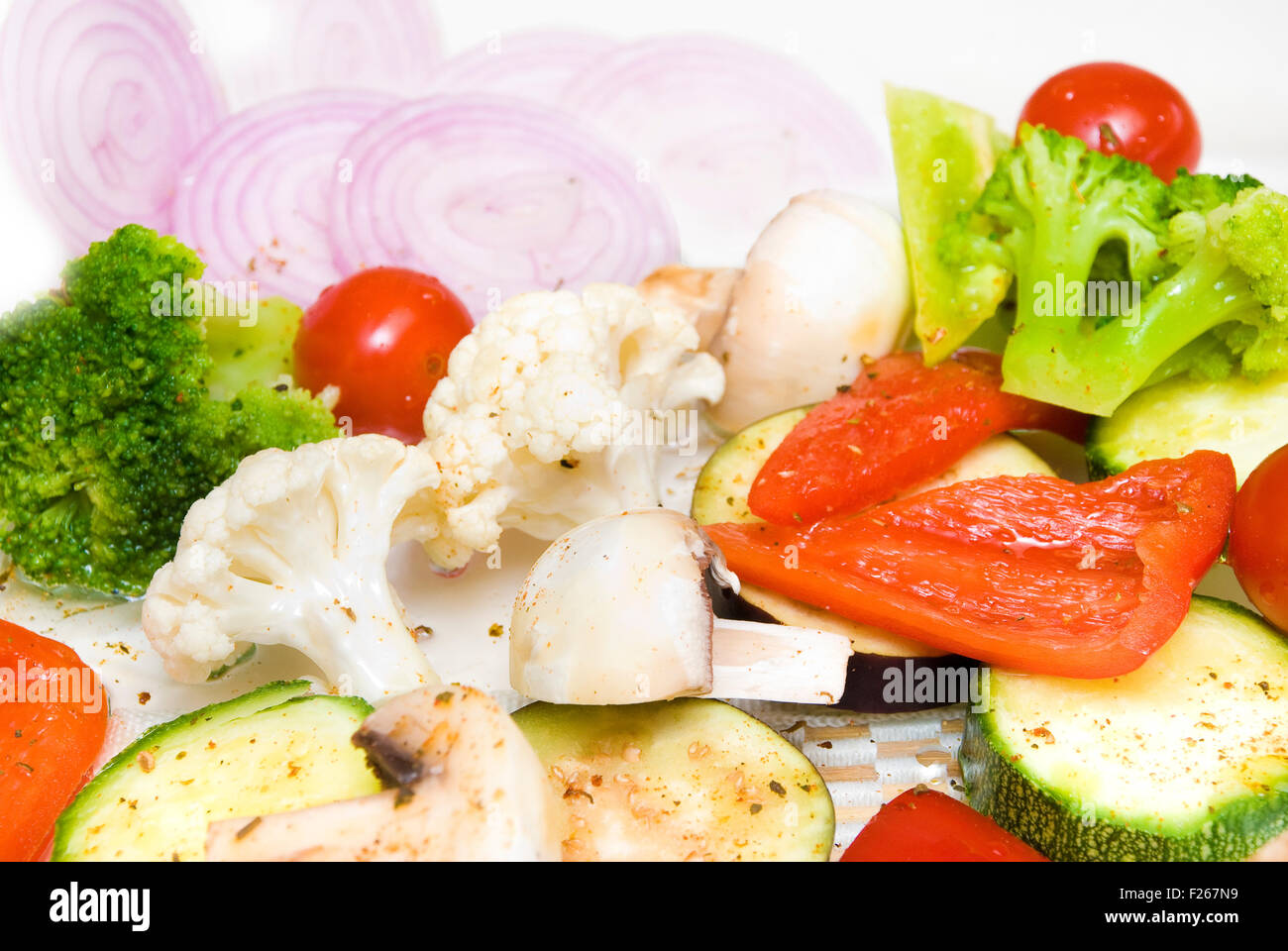 Many small sliced colorful vegetables - Stock Image