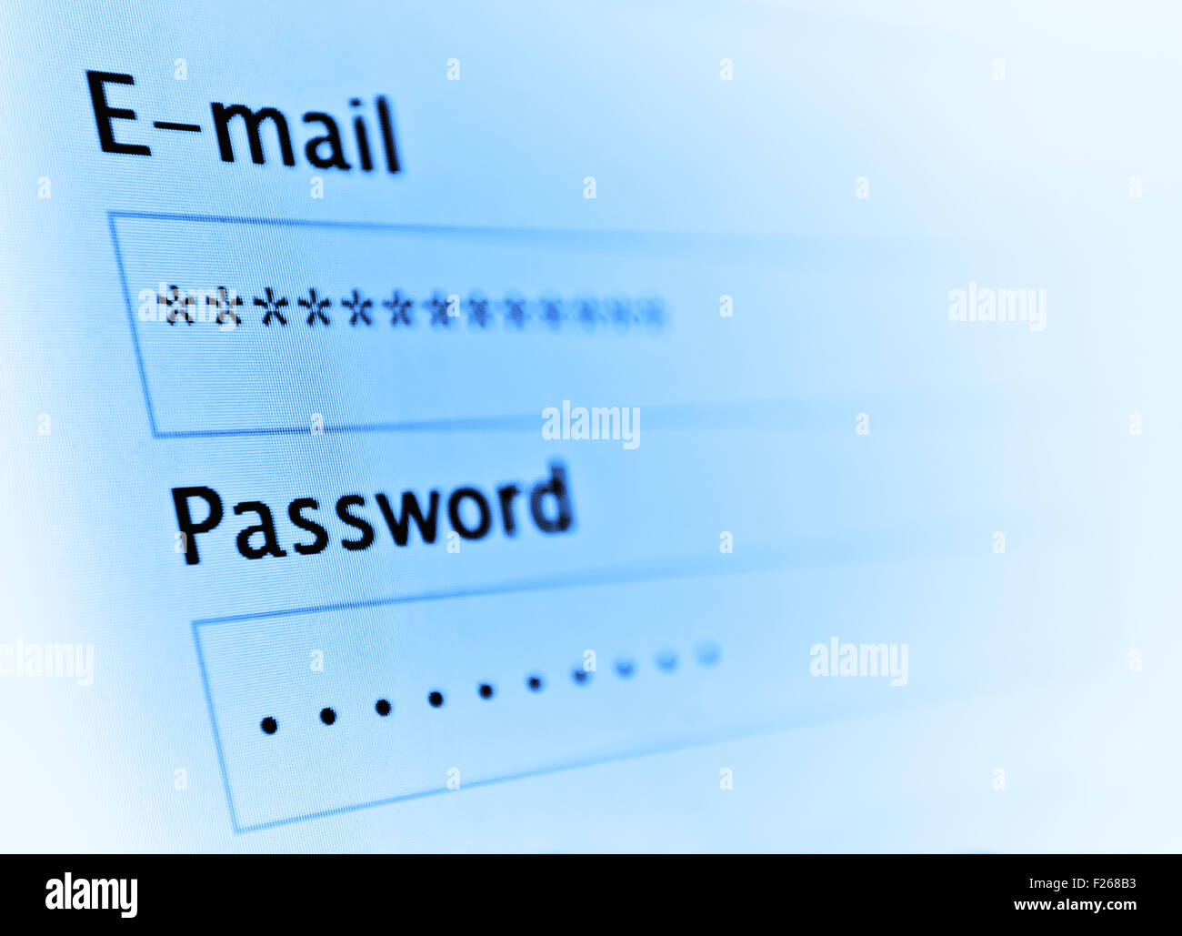 Login and password on monitor screen. Toned on blue Stock Photo
