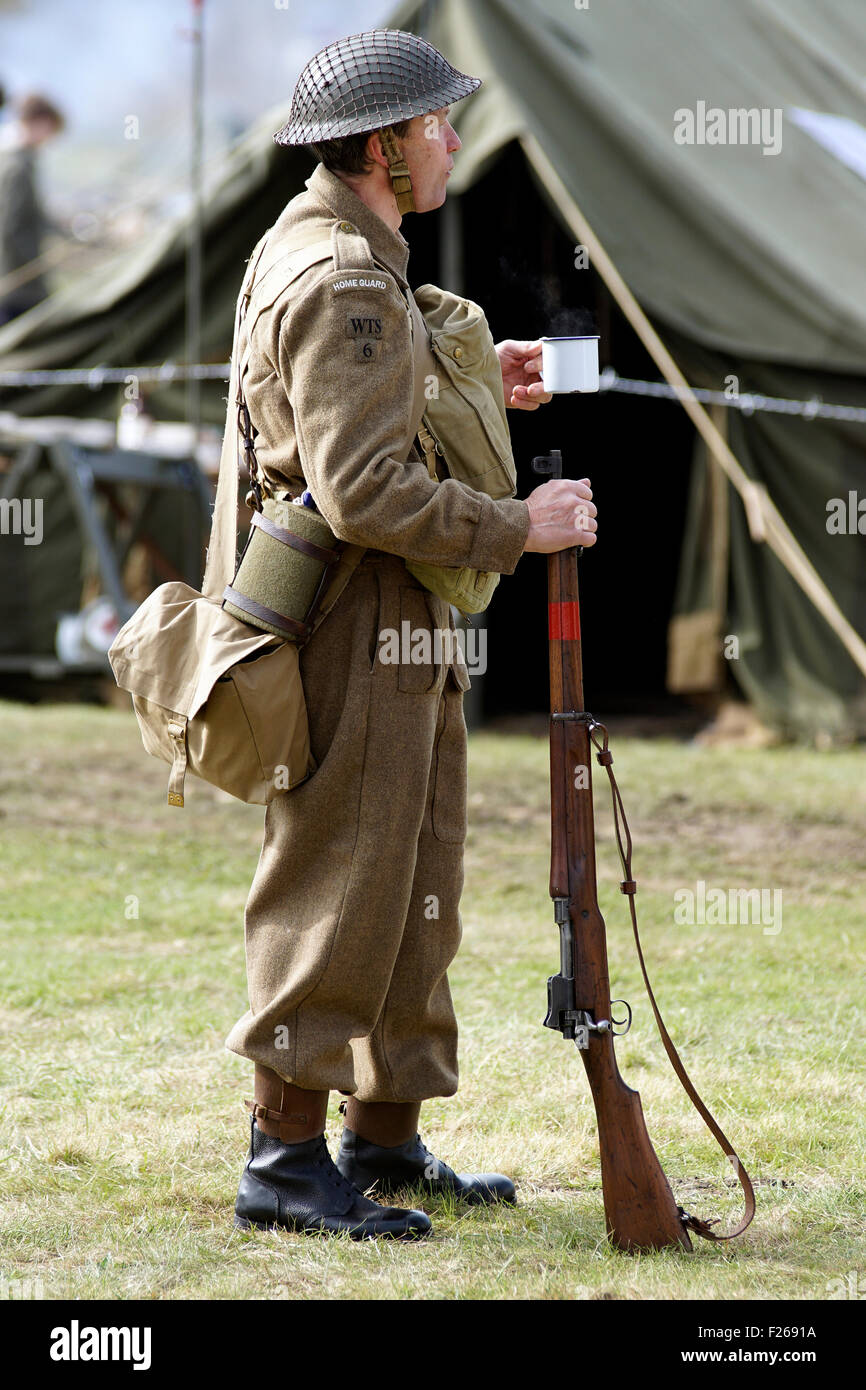 A re-enactor dressed in the uniform of a WW2 British Army Home Guard Soldier - Stock Image