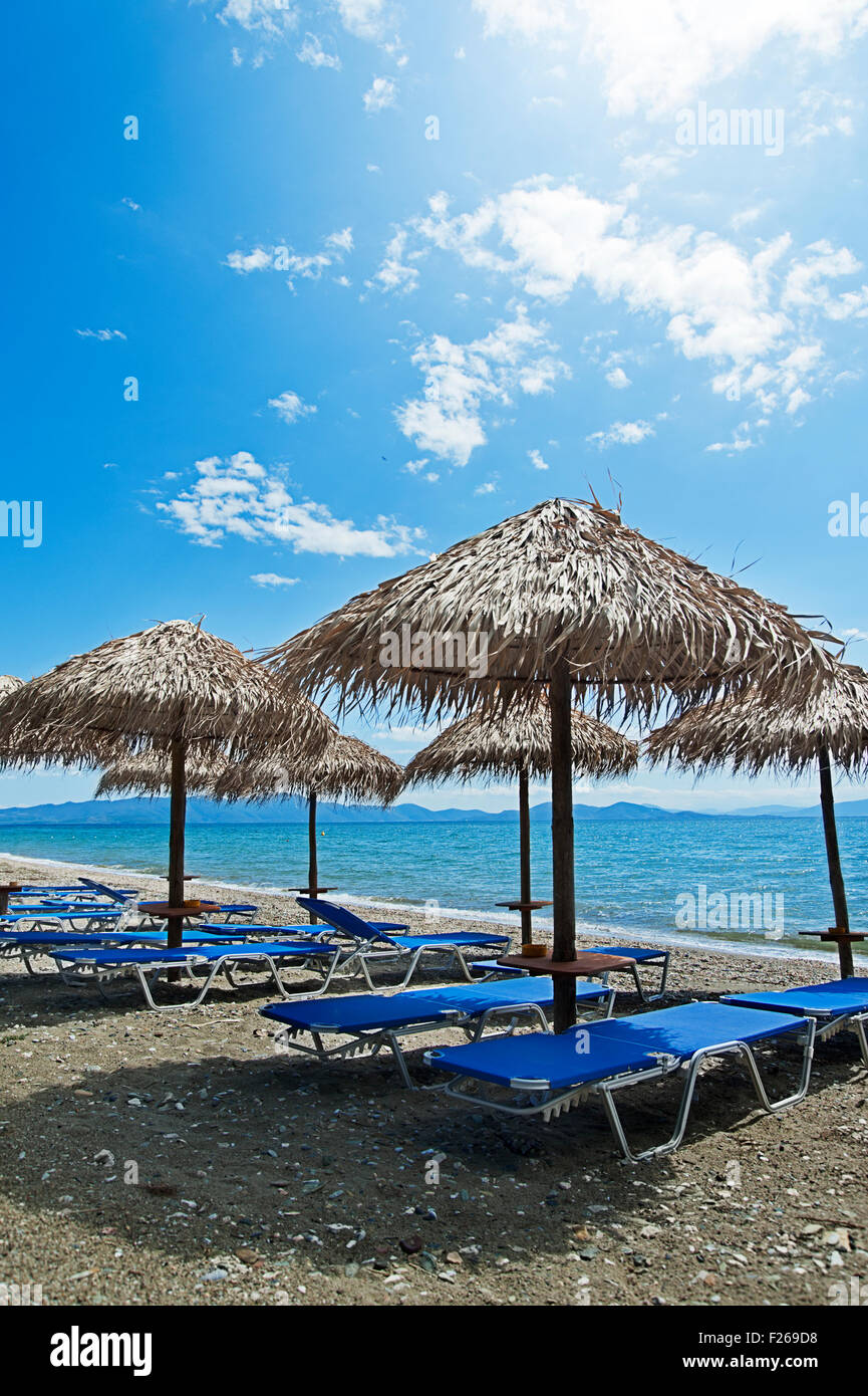 Beach with empty sunbeds and parasols on Pelion Peninsula, Thessaly, Greece Stock Photo