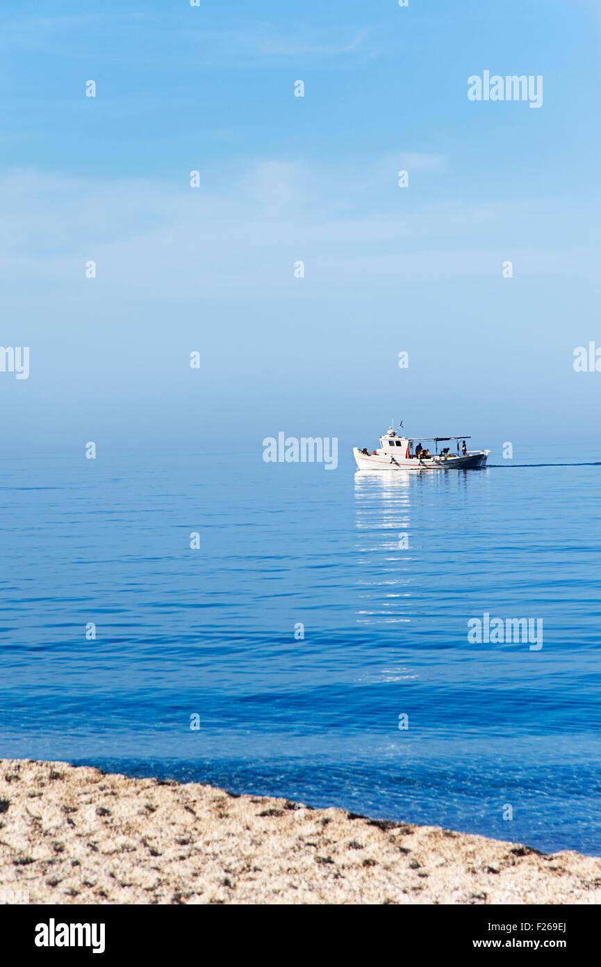 Fishing boat off shore Pelion Peninsula, Thessaly, Greece - Stock Image