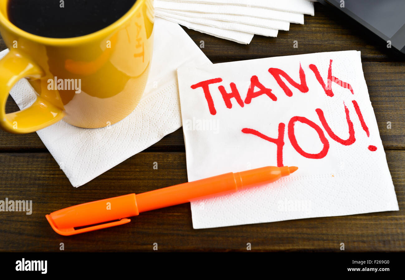 Thank you - motivational handwriting on a napkin with a cup of coffee and phone - Stock Image