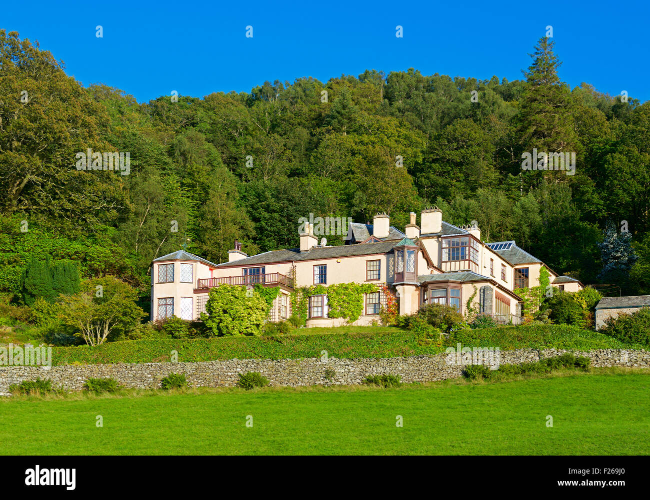 Brantwood, home of writer and art critic John Ruskin, on the shore over Coniston lake, Lake Lake District National - Stock Image