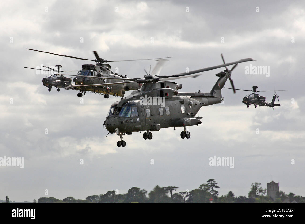An Agusta Westland Merlin HC Mk 3 from 846 NAS with a Sea King H C MK 4 from 848 NAS with a pair of Army Air Corps - Stock Image