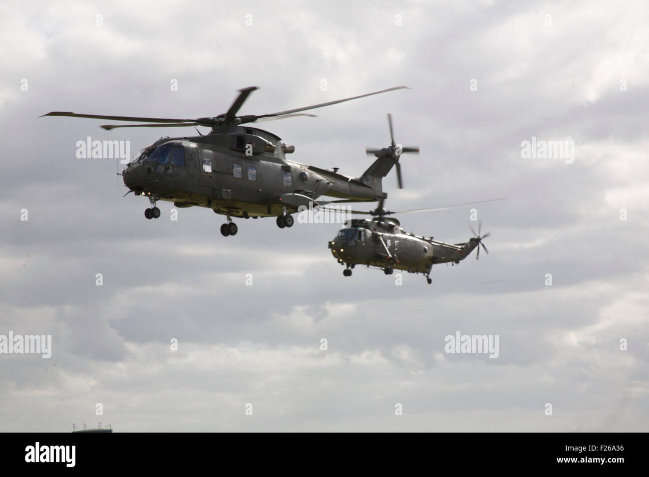 An AgustWestland Merlin H C Mk 3 from 846 NAS fllies with Wesland Sea King H C MK 4 from 848 NAS - Stock Image